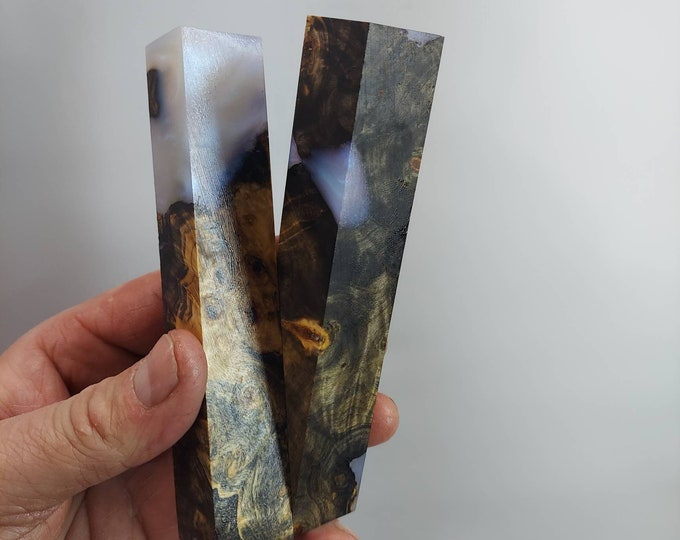 Gorgeous stabilized buckeye burl and color shift resin hybrid pen blanks.