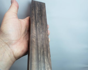 Large epoxy knife or handle material. Metallic chocolate color.