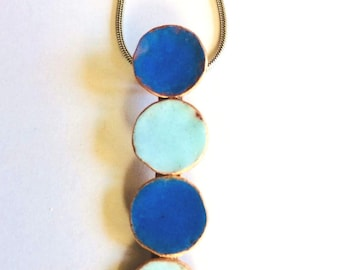Small handmade enamel necklace; light and dark and blue circle pendant