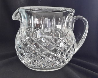 Crystal pitcher for milk or juice a diamond pattern around and with vertical cuts towards the top
