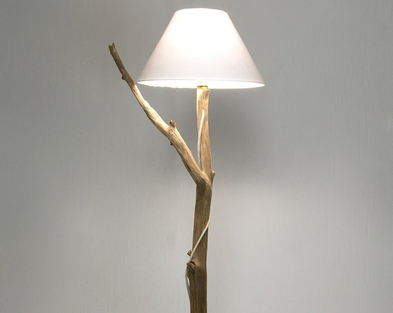 Unique wooden floor lamp with lamp shade with a beautiful branch