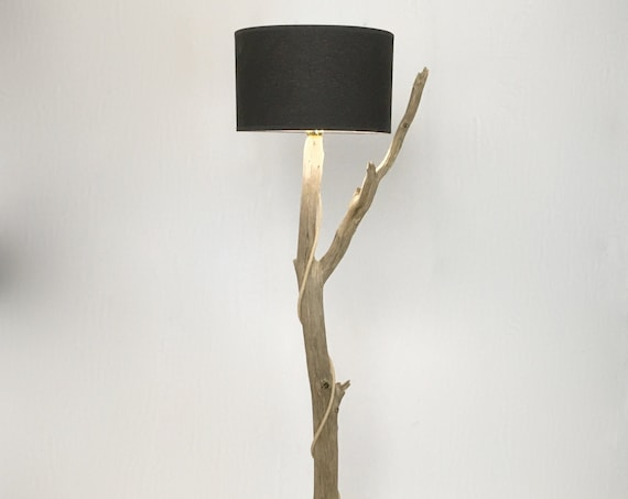 Unique wooden floor lamp with black lampshade with a beautiful branch