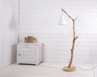 Small wood standing lamp with a nice branch, white metal shade