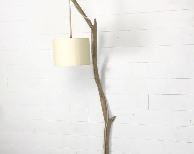 Nice wall lighting with a big weathered branch