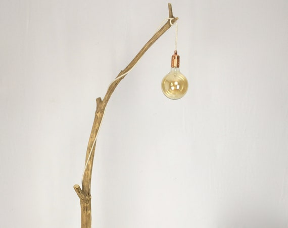 Weathered natural wood floor lamp with hanging vintage bulb and jute flex