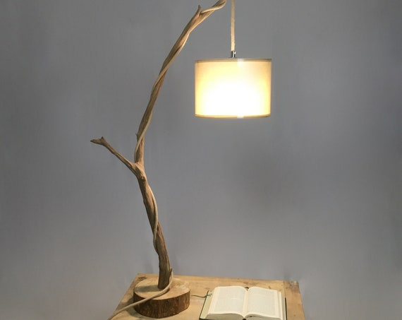 Table lamp with a weathered branch, rope cable and cotton lampshade
