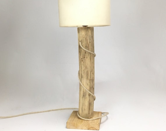 Driftwood accent lamp with wooden base and cloth cable