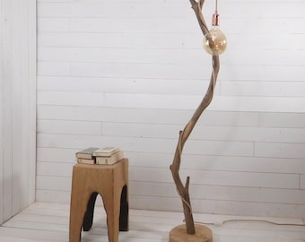 Natural twisted wood standing lamp with exposed bulb