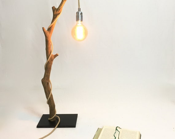 Table lamp with a weathered branch, rope cable and edison bulb