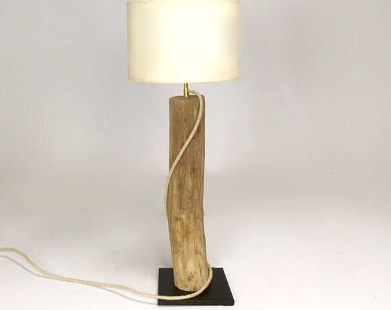 Driftwood accent lamp with black steel base and cloth cable