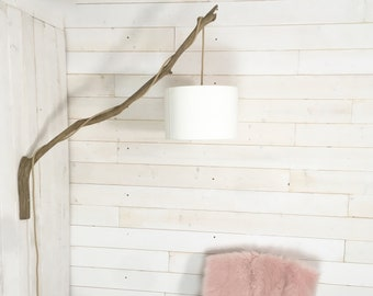 Nice wall lighting with a big weathered branch