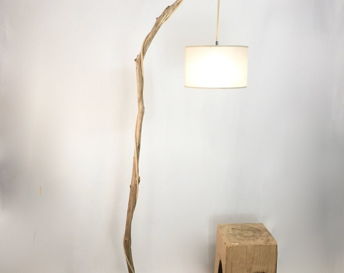Old branch floor lamp with white  hanging lamp shade and cloth cable