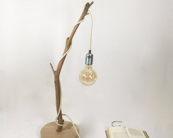 Rustic natural wood lamp with a hanging bulb and cloth flex