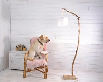 Natural minimalist wood floor lamp with a branch