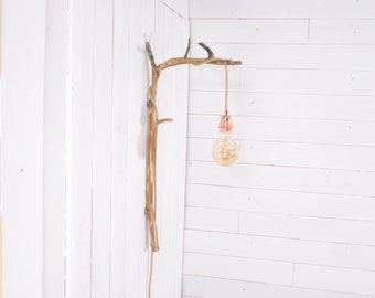 Natural wall lamp with a branch for hanging light