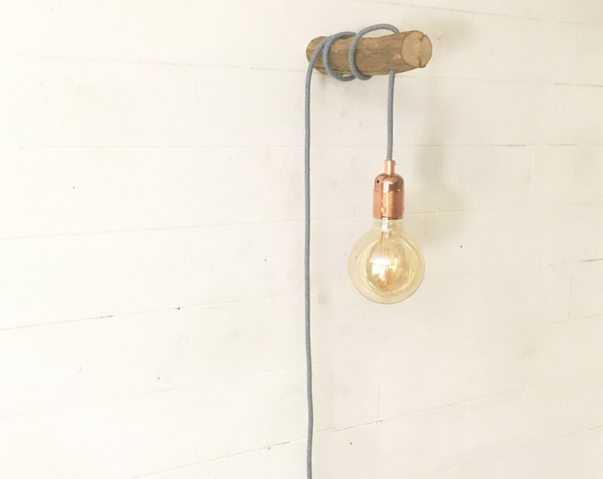 Wooden wall lamp with hanging bulb