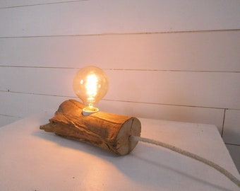 Edison wooden lamp with an old branch and cloth cable