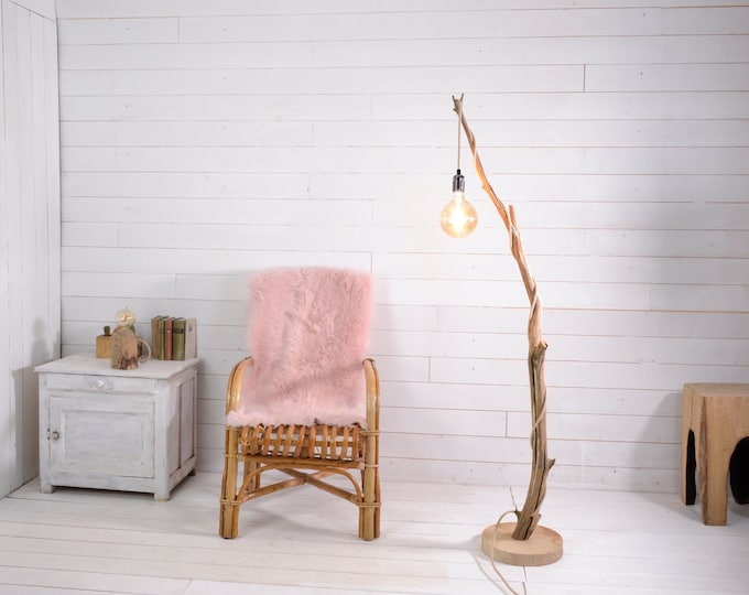 Floor lamp with a terrific weathered branch, exposed bulb and cord