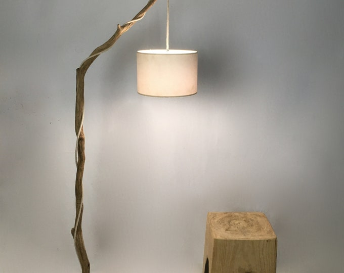 Thin weathered branch standing lamp