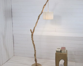 Weathered branch floor lamp with hanging light