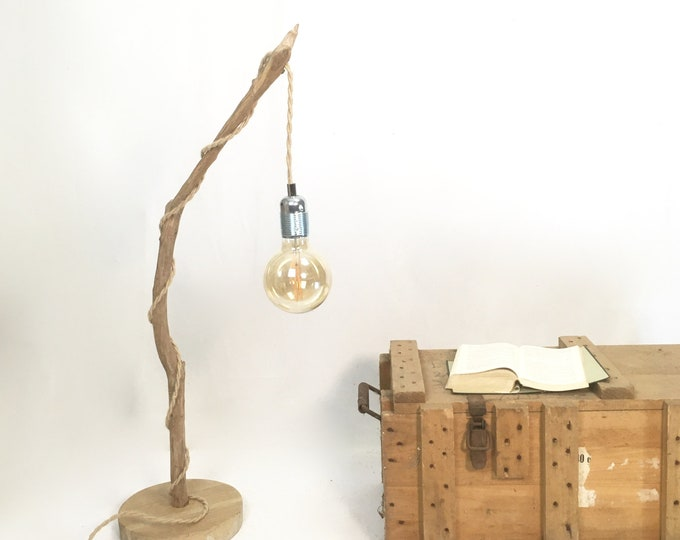Rustic natural wood lamp with a hanging bulb and braided jute flex