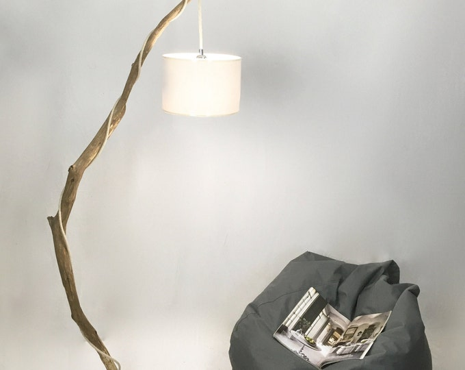 Old branch floor lamp with white hanging lampshade and cloth cable