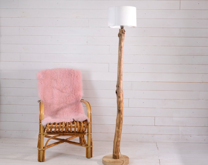 Wooden floor lamp with a nice weathered branch