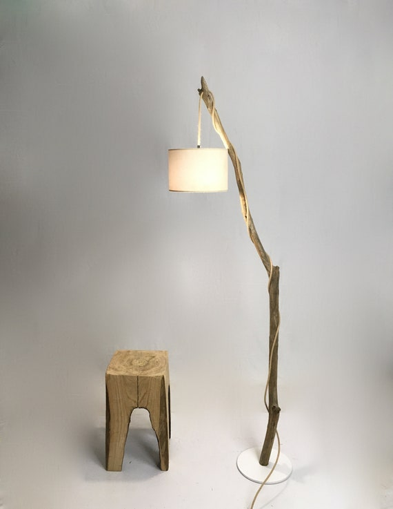 Old branch floor lamp with grey lamp shade and cloth cable