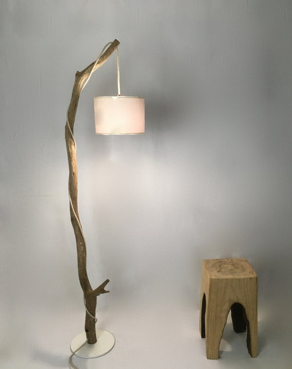 Old weathered branch standing lamp