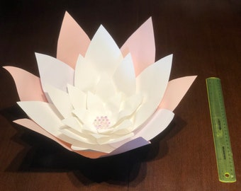 """Large paper flower aprox. 18"""", great for party or room decor. Includes adhesive strip for easy mounting."""