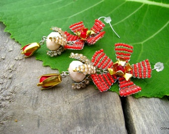 Long red earrings from beads and coral.
