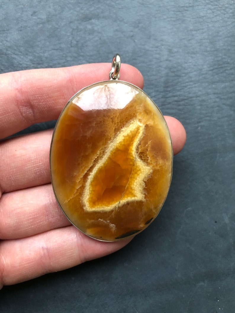 Pendant with stone simbircite Look video on YouTube! Frame Nickel silver