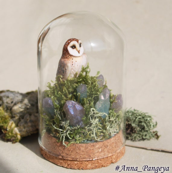 Spring owl. Sculpture in a glass dome