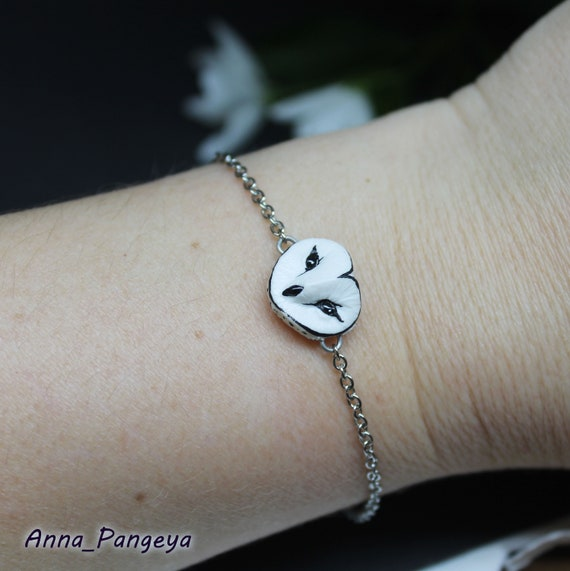 Bracelet on a chain with a white owl