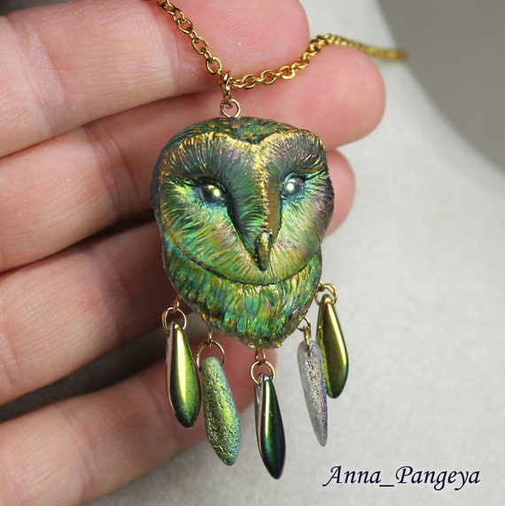 Pendant with an owl. Mysterious forest
