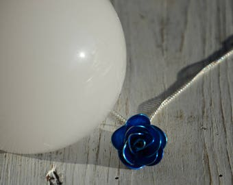 Electric blue rose pendant