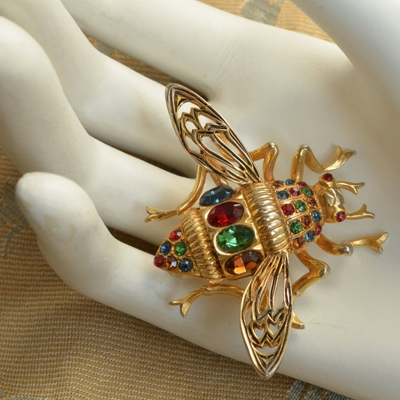Vogue's golden vintage beetle insect seam brooch