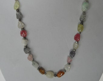 Ice flake quartz crystal in multi colors are combined with pewter rounds for an elegant necklace.