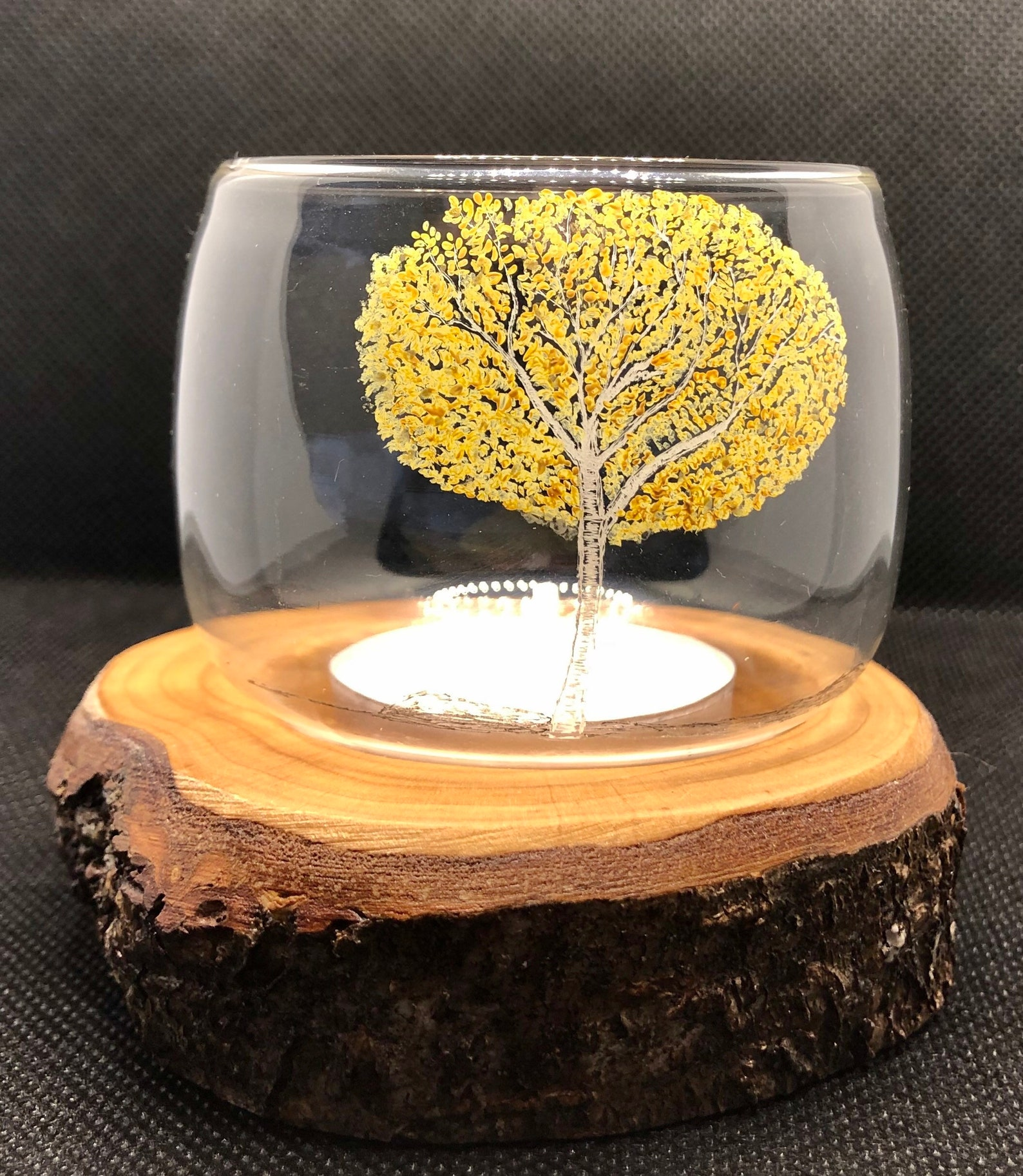 Single glass tealight holder with freehand autumn white birch tree engraving and Dartmoor wood base
