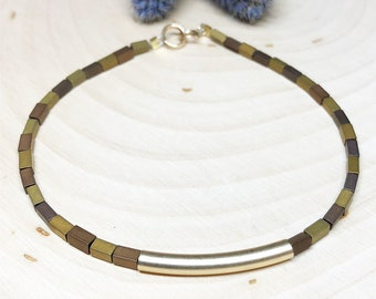 Gold-tone Hematite Bracelet with Curved Brass Bar 7.5 inches