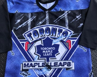 cbcef830 Vintage 90s Toronto Maple Leafs CCM all over print NHL Jersey