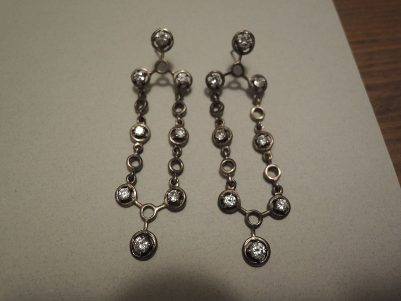 Sterling 925 pierced earrings 1970 era 2.5 inch long  Dangle type with bezel set colorless Yag type gems in good condition