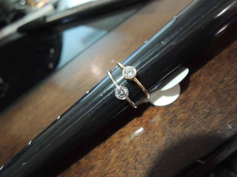 6 or 7  two shown are size 6 Silver Bezel set CZ rings can be ordered size 5