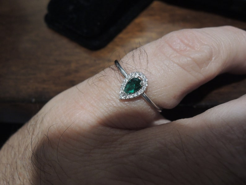 Sterling Halo Pear shaped ring Order in sterling white gold synthetic man-made gems or natural model is size 8