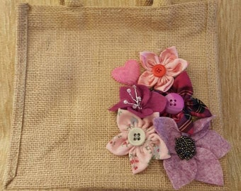 Small jute bag embellished with handmade felt and fabric flowers