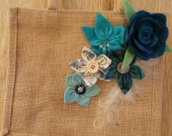 Small jute bag embellished with handmade flowers