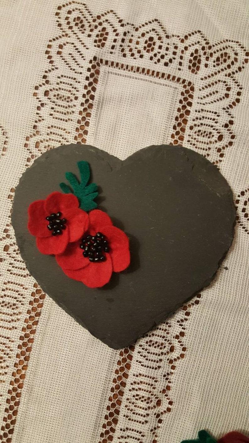 Double beaded poppy brooch