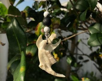 Muskrat jaw bone pendant