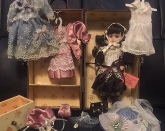 Trudy Traveler Porcelain Doll with Three Outfits & Accessories and Travelling Trunk