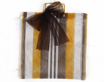 Original bag 60s customized by the brand. Made in Spain. Golden handles. Brown stripes and tulle ribbon.